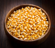 Kernels, Corn seeds on wood bowl Stock Photography