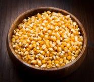 Kernels, Corn seeds on wood bowl. Some kernels, Corn seeds on wood bowl Stock Photography