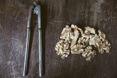 Kernels of walnuts and nutcracker Stock Photo