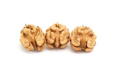 Kernels of walnuts on a white. Royalty Free Stock Photo