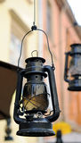 Kerosene lamp on the background of the old house, the old street Stock Images