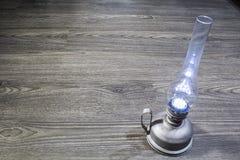 Kerosene lamp on floor. Old oil lamp with a light bulb on the floor Stock Photos