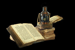Kerosene lamp and old books. Royalty Free Stock Images