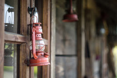 Kerosene lamp and old house Royalty Free Stock Image