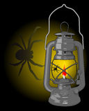 Kerosene lamp with a spider. On a black background Royalty Free Stock Photos