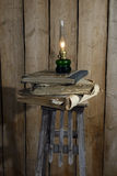 Kerosene lamp and stack of old books Stock Image
