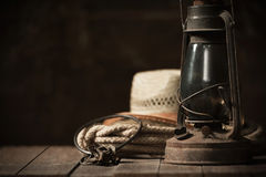 Kerosene lamp on the table in the barn Stock Photography