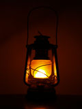 Kerosene oil lantern. Glowing kerosene oil lantern ablaze against dark night sky royalty free stock photography