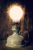 Kerosine lamp. Is burning on the electric lamp Royalty Free Stock Photography