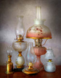 Kerosene Lamps. An assortment of glass oil lamps Stock Photo