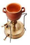Kerosinebrander en ceramische pot Stock Afbeelding