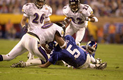 Kerry Collins sacked in SB XXXV. New York Giants QB Kerry Collins is sacked by the Ravens defense during SB XXXV. (Image taken from color slide Royalty Free Stock Photos