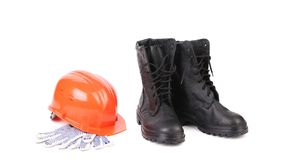 Kersey boots and hard hat on gloves. Stock Photography