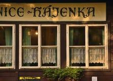 Kersko, Czech republic - July 07, 2018: windows of brasserie Hajenka from czechoslovakia film Slavnosti Snezenek by director Jiri. Menzel stand along road named Royalty Free Stock Photos