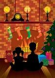 Kerstavond door de open haard Stock Fotografie
