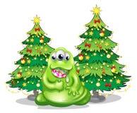 Kerstbomen bij de rug van het monster met een lolly Stock Foto