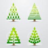 Kerstbomen, reeks gestileerde vectortekens Stock Foto