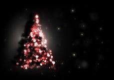 Kerstboom die op zwarte glanst Stock Foto's