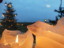 Kerstboom en kaars stock foto's