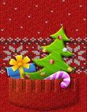Kerstboom, gift, suikergoedriet in gebreide zak Stock Fotografie