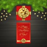 Kerstboom, giftdoos, slinger, gouden lintboog Stock Foto
