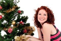 Kerstboom, jonge gelukkige vrouw. Royalty-vrije Stock Foto's