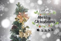 Kerstboom met decoratie en sneeuwvlok op bokeh Stock Afbeelding