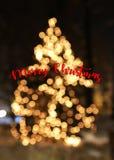 Kerstboom met lichten gloeiende kaart Stock Afbeeldingen