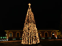 Kerstboom met lichten het gloeien Stock Foto