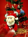 Kerstboom met santa Stock Afbeeldingen