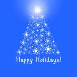 Kerstboom op blauwe achtergrond royalty-vrije stock afbeeldingen