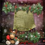 Kerstkaart met een verfraaide groene tak en speelgoed en met een lege plaats voor tekst royalty-vrije stock foto's