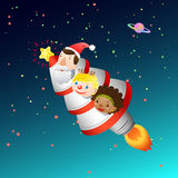 Kerstkaart met raket en jonge geitjes Stock Fotografie
