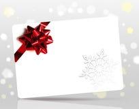 Kerstkaart met rode boog Stock Fotografie