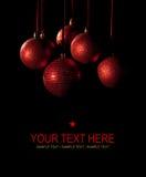 Kerstkaart - rode ballen op zwarte achtergrond Royalty-vrije Stock Afbeeldingen