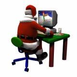 Kerstman die aan een Computer werken Stock Afbeelding