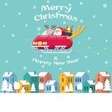 Kerstman die arauto over de winterstad vliegen Stock Afbeeldingen