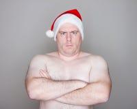 Kerstman die camera bekijken Stock Foto's