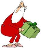 Kerstman die een giftdoos opnemen Stock Foto's