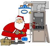 Kerstman die een Oven bevestigen Royalty-vrije Stock Afbeeldingen