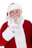 Kerstman die een vinger houden aan zijn mond stock afbeelding