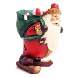 Kerstman die een zak dragen Stock Foto