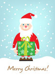 Kerstman die giftkaart houden Stock Foto