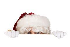 Kerstman die grens verbergen Royalty-vrije Stock Foto's
