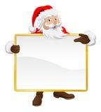 Kerstman die het teken en het richten van Kerstmis houden Stock Foto's