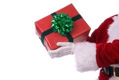 Kerstman die huidig houden Stock Foto