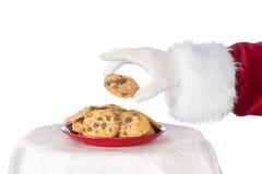 Kerstman die koekje grijpen Stock Afbeelding