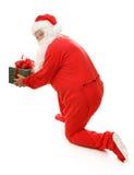 Kerstman die met Gift wordt gevangen Stock Afbeeldingen