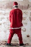 Kerstman die op een Muur urineren Stock Afbeeldingen
