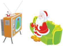 Kerstman die op TV letten royalty-vrije illustratie
